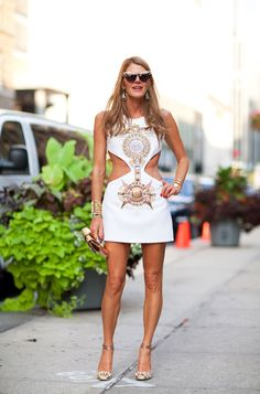 STREET STYLE SPRING 2013: NYFW - Anna Dello Russo shows off her abs in a white Versace dress with cut-out detail