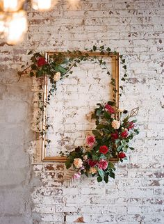 Last Minute Love Notes to Buy or DIY | A little gold paper and wooden sticks will make it possible to create your own Cupid's arrow Valentine. Perfect for Valentine's Day wedding decorations like this floral frame.