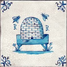 Beehive tile;contemporary by English ceramics artist Paul Bommer, in 18th c. Dutch style. This one honors an urban bee keeper.