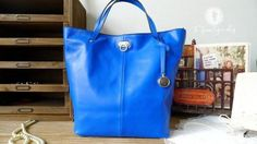 Hand Stitched Leather Tote Bag / Briefcase / Cross Body Messenger Bag / Laptop Bag in Blue. $135.00, via Etsy.