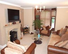 photo of beige lounge with fireplace wood burner