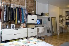 ikea wall unit. multifunctional as it houses desk and drawers and hanging space