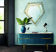 Sideboards are usually made out of wood. Edith it's not, that's why it is a distinctive piece to furnish your living room. It is upholstered with a soft velvet, and stands out for its high-end look at the top, making use of a grey textured marble. It features a curvilinear body with sleek and simple legs made of brass, that contrasts with strong accents of gold. A statement storage piece for the retro chic lovers.
