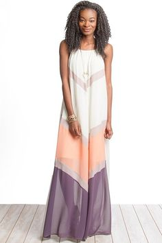 Sleeveless color block maxi in peach and cream colors. Lined. Back is solid color. Silk/Polyester blend.