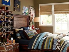 "Darker tan walls and nearly matching roman shades in window  helps the colorful bed stand out without making the room feel ""too much."""