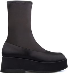 This Camper shoes #Wilma platform boot reimagines a retro silhouette for a contemporary era.