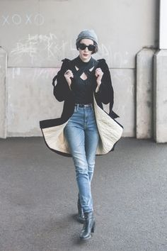 She figured throwing in a beanie and dark cat eye sunglasses oddly ensured her safety (at least in her mind). The color black carries a lot of connotations.