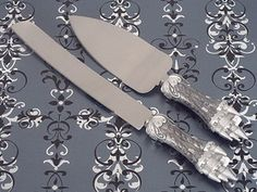 "The perfect accessory for your fairytale themed event.  Each of these sturdy stainless steel cake and knife servers are accented with life like sculpted castle design handles and are highlighted in an elegant pewter silver epoxy enamel finish. The prefect touch for your enchanted evening , the cake server measures 10"" and the cake knife 12"" long and come packaged in beautiful display gift box.   #timelesstreasure"
