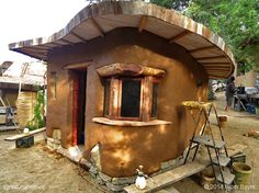 The wooden window lintel fits the curve of the wall perfectly. This was not a lucky find. The building's design was determined by the materials available rather than designing the building and then finding the materials to build it. You can see the build steps at www.naturalhomes.org/huckleberry.htm