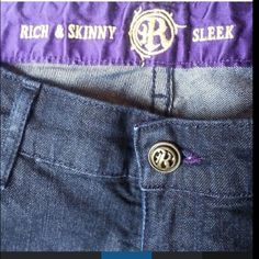 "RICH & SKINNY Sleek Jeans Like new, dark wash w/purple satin stitching & insidewaistband. Gold embellishment stitching. Size 29, Inseam 27"" & outside length from waist to bottom hem 36"", waist 15.5"", Top button to crotch 8"" ( sits low on hips & below belly button) the backside is 12"" waist to crotch. ( the back waist is higher ) Rich & Skinny Jeans Skinny"