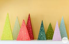 Add a pop of bold color and DIY-style to your Christmas decorations with these DIY Colorful Wood Christmas Tree Decorations Pallet Christmas Tree, Christmas Tree Crafts, Colorful Christmas Tree, Noel Christmas, Homemade Christmas, Winter Christmas, Christmas Tree Decorations, Holiday Crafts, Holiday Decor
