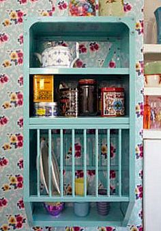 A plate rack with space for cups and my son's teas. Hang it above the pie safes in the dining room.
