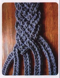 Braid five strands of double crochet chains. Imagine the braid in five different colors!