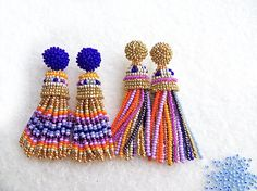 I made these long beaded tassel stud earrings with high quality charlotte Czech seed beads. Here is a link to short clip video with this earrings: https://www.instagram.com/p/BVH4EtdjUGs/?taken-by=julimarbeads Inspired by Oscar de La Rents, handmade by me. You can choose earrings which You preffer mostly - stud or clip and gold top or blue top. Stud Earrings with blue top are little shorter (6.5 cm or 2.56 in). Earrings with gold top: 7 cm or 2.76. Clip on earr...