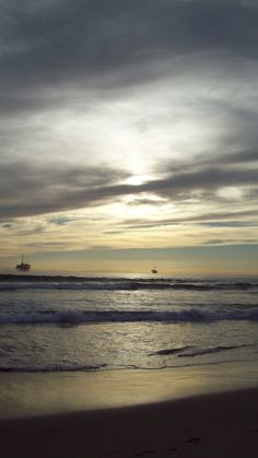 Huntington Beach Sunset.  I'd sit for hours as a kid, wondering what lay at the other end of this ocean...