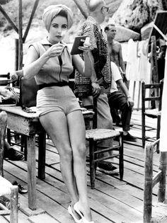 Elizabeth Taylor tends to her makeup on the set of Suddenly, Last Summer, 1959.