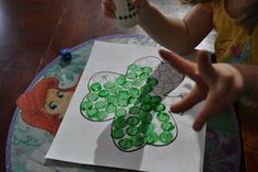 Free roll and cover shamrocks.  Great for counting!
