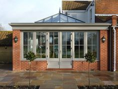 Orangery with brick corners, roof lantern and matching doors / windows. Orangery with brick corners, roof lantern and matching doors / windows. Orangery Extension Kitchen, Orangerie Extension, Kitchen Orangery, Conservatory Extension, Orangery Roof, Orangery Conservatory, House Extension Design, Roof Extension, Glass Extension