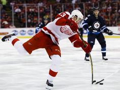 TORQUE! Red Wings center Pavel Datsyuk (#13) takes a shot in the third period of the Wings' 3-2 win over the Jets Thursday at the Joe Louis Arena.  Rick Osentoski USA TODAY Sports
