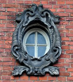 Ornate window in Amsterdam by Michiel2005, via Flickr