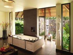 Mauritius resort villas are filled with sunlight and sublime views of mountains, mangroves and the azure-coloured beachfronts - yes, even the baths!