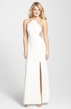 Free shipping and returns on Morgan & Co.  Illusion Back Gown at Nordstrom.com. A sweeping halter gown is studded with icy beads that highlight the curvaceous bodice and continue to twinkle across the illusion back. A thigh-high slit affords a dramatic glimpse of leg.