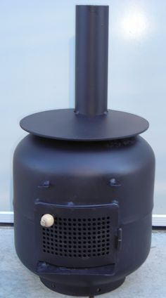 Heater/ Cooker made from recycled propane tanks