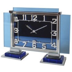 French Blue Glass & Chrome Jaz Art Deco Clock   From a unique collection of antique and modern clocks at http://www.1stdibs.com/furniture/more-furniture-collectibles/clocks/
