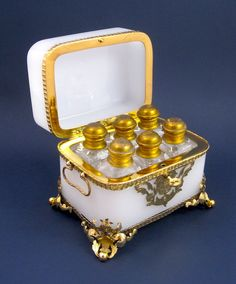 Baccarat 19th Century Opaline Scent Casket with 6 Original Scent Bottles  with Traditional Baccarat `Flower` Stoppers and all with Inside Stoppers from Grand Tour Antiques on Ruby Lane