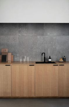 Modern Kitchen Interior Norm Architects' Studio in Copenhagen. Their kitchen design in sawn cut natural oak. It's an IKEA hack. - Norm Architects' design in sawn cut natural oak with handles in black coated steel.