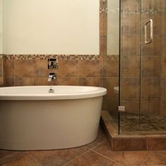 Travertine Tile Surrounds The Bathtub In This Bathroom Remodel Brilliant Austin Tx Bathroom Remodeling Inspiration Design