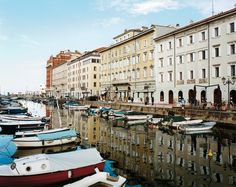 SEA FAIR Stately, 19-century Austrian-style buildings line Trieste's Grant Canal. Photographs by Domingo Milella