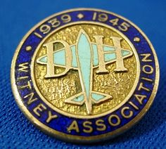 """Brass & Enamel De Havilland Aircraft Company 1939 1945 Witney Association lapel badge. Issued to employees of the De Havilland Aircraft factory who built the planes during the Second World War. This is a very scarce example.  Measures 3/4"""" (2cm) high.  In Very Good Condition, with no damage to enamel."""