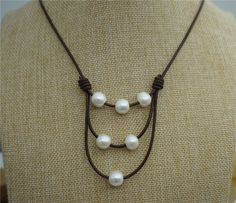 A personal favorite from my Etsy shop https://www.etsy.com/listing/228013701/11mm-big-pearl-necklaceleather-pearl