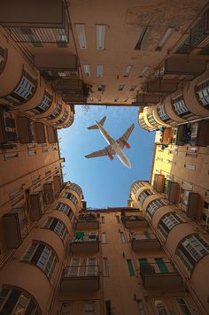 Capturing the moment, aircraft between buildings