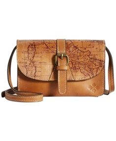 """Wrapped in a beautifully rich, printed leather case, this clever organizer features an adjustable crossbody strap for a custom fit. By Patricia Nash. 