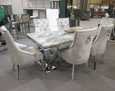 Table Size : The Belle knockerback chair is a modern style and well covered with velvet in a soft pewter colour. Dining chairs legs are underneath the chair zip pad. Table Material : Stainless Steel with Marble Top. Marble Dining Table Set, Grey Dining Tables, Dining Chairs, Grey Table, Table Sizes, Grey Chair, Dining Room Design, Pewter, Velvet Chairs