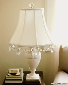 If you can't afford a crystal lamp, but want a little bling, add some chandelier crystals  to your lampshade. You can buy them new or find them at flea markets.