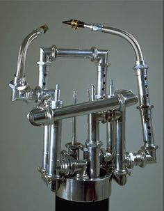 """Due Capi- Italian for ""Two Heads"", the instrument is made from aluminum, wood, drum heads, and contains piezo pickups"
