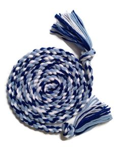 Our Ocean Waves Jump Rope, made with light blue, dark blue and white 100% acrylic yarn.  Measuring approximately 7' in length.  It's a great cardiovascular workout for the entire family.