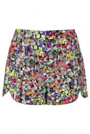 All over printed shorts with scallop hem detail. Co-ords to Bomber jacket. 100% Polyester. Wash with similar colours.