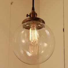 "Hanging Pendant Light Fixture with 8"" Glass Globe Shade and Exposed Socket. $118.00, via Etsy."