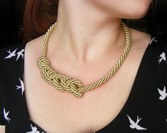 Nautical rope necklace, gold rope necklace, spiral knot necklace, rope jewelry. $35.00, via Etsy.
