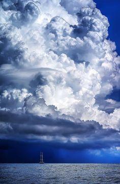 Enormous cumulus clouds.