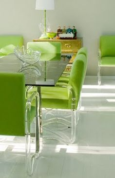 Lucite chairs and lime green upholstery.