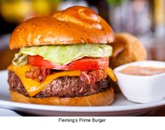 Sandwich - Hamburger...gourmet and standard toppings...ketchup, mustard, aioli, mayo, various cheeses, bacon, tomatoes, lettuce, jalapenos, onions-fried and fresh, chili, southern slaw, honey-mustard, teriyaki sauce, chinese cabbage slaw, tomato sauce, prosciutto, kraut, pickles, etc...