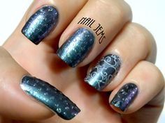 Stormy night mani with colour shifting polish, stamped cloud design and glitter topper rain drops.