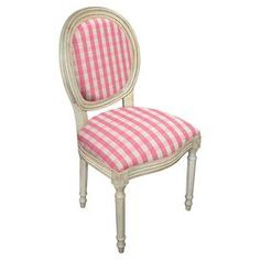 "Perfect placed at the head of your dining table or accenting the living room seating group, this elegant wood side chair showcases plaid upholstery and an antique white finish.  Product: ChairConstruction Material: Cotton-rayon blend and solid woodColor: Pink and antique whiteFeatures:  Hand-carvedPlaid print19"" Seat height Dimensions: 37.5"" H x 19.5"" W x 20.5"" DAssembly: No assembly required - ships fully assembled"