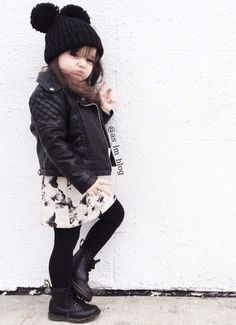 Cute little girl with a good fashion and attitude.