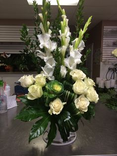 White gladiolus, white roses, kale with aspidistra leaves & other greenery by Donna Jeffries